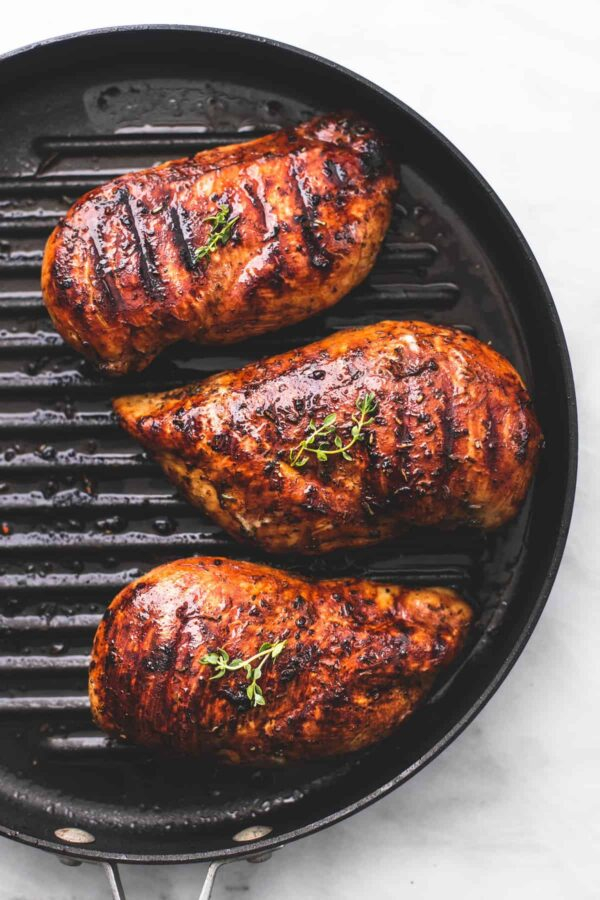 3. Preheat grill to medium heat and grill chicken 5 to 6 minutes on each side or until cooked through (internal temp should be 165 degrees)